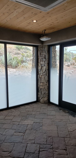 Decorative film installed with a gradient pattern to block out only about half of the glass. Scottsd