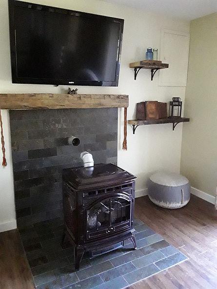 New wood fireplace on slate flooring