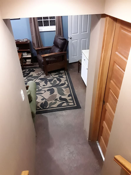 Renovated garage with leather chair and carpet