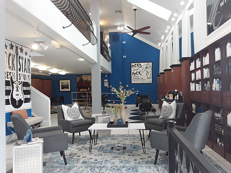 Refurbished hair salong with seating area and blue walls