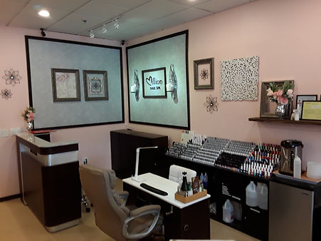 Reception area for nail salon with desk