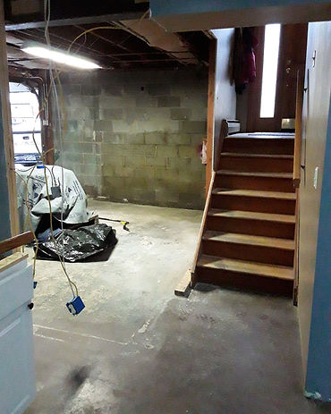 Old wooden stairs and concrete wall with exposed wires