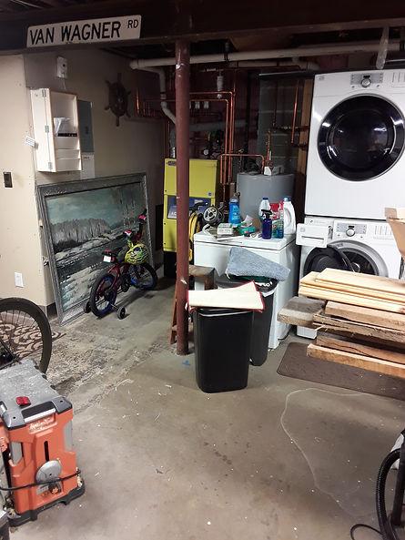 Dirty garage with washing machine and dryer