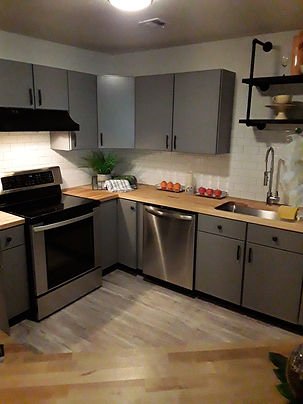 Newly refurbished kitchen with steel appliances and wooden flooring
