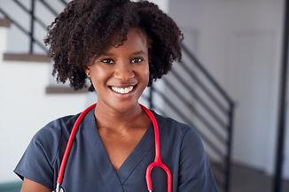 portrait-of-female-nurse-wearing-scrubs-in-hospita-ZV6RKX4.jpg