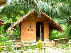 Stay in one of Din Daeng's clayhuts