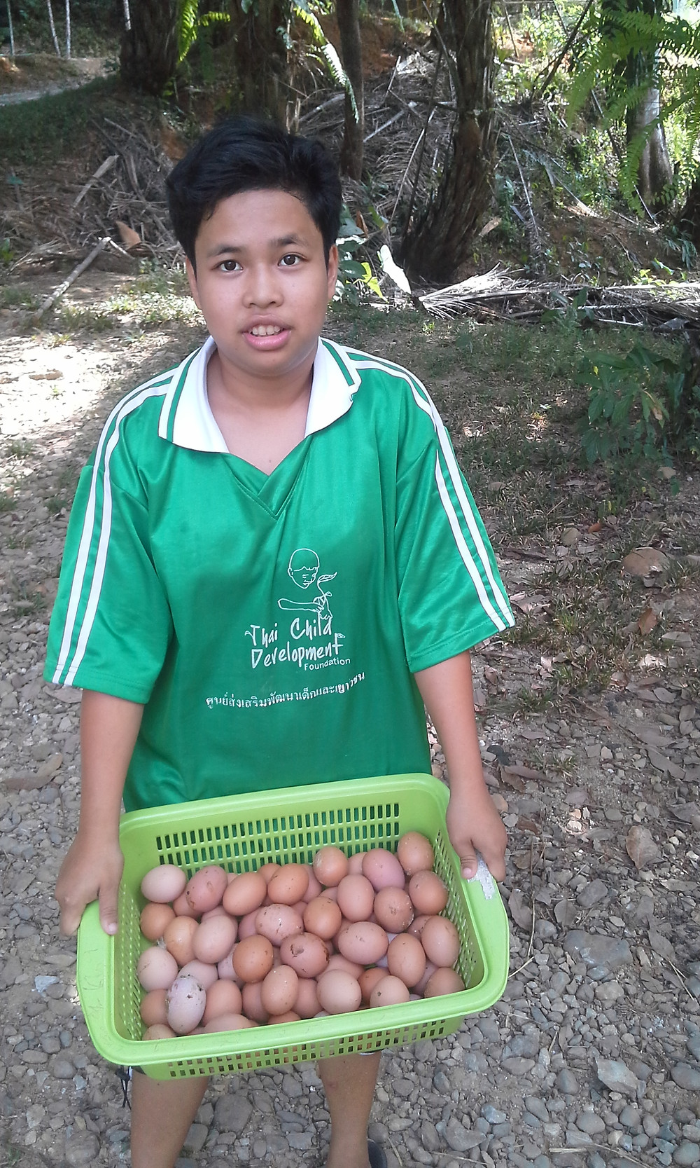 Collecting the fresh eggs of TCDF's chicken farm is one of her jobs