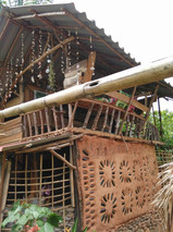One of Dindaeng's clay houses