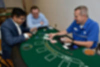Board member Rob Ruddick deals blackjack