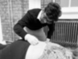 Chiropractor performing Acupuncture .JPG
