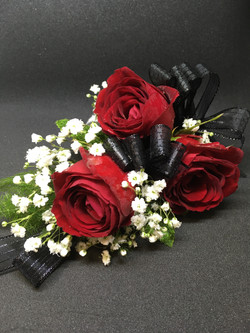 Red roses and black ribbon