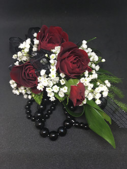 Red spray rose corsage with black