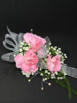 Pink minicarnation corsage
