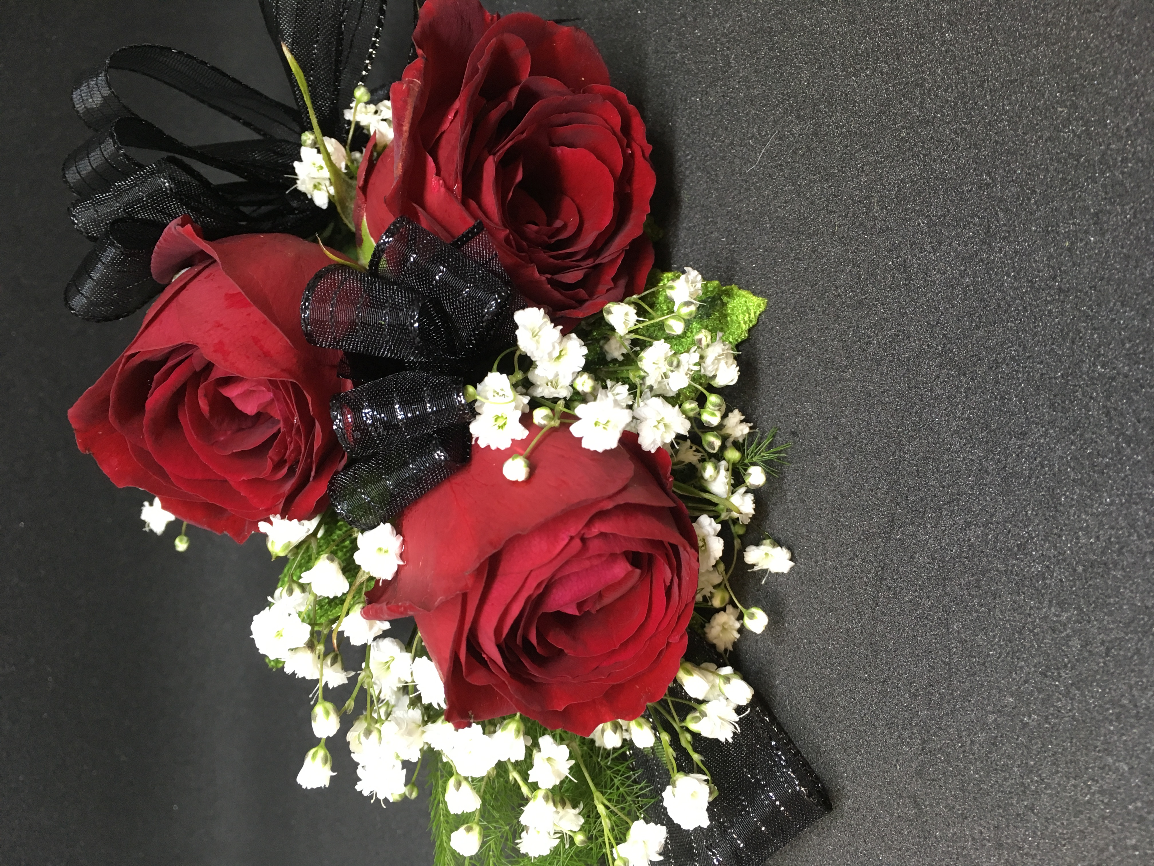 Red roses corsage