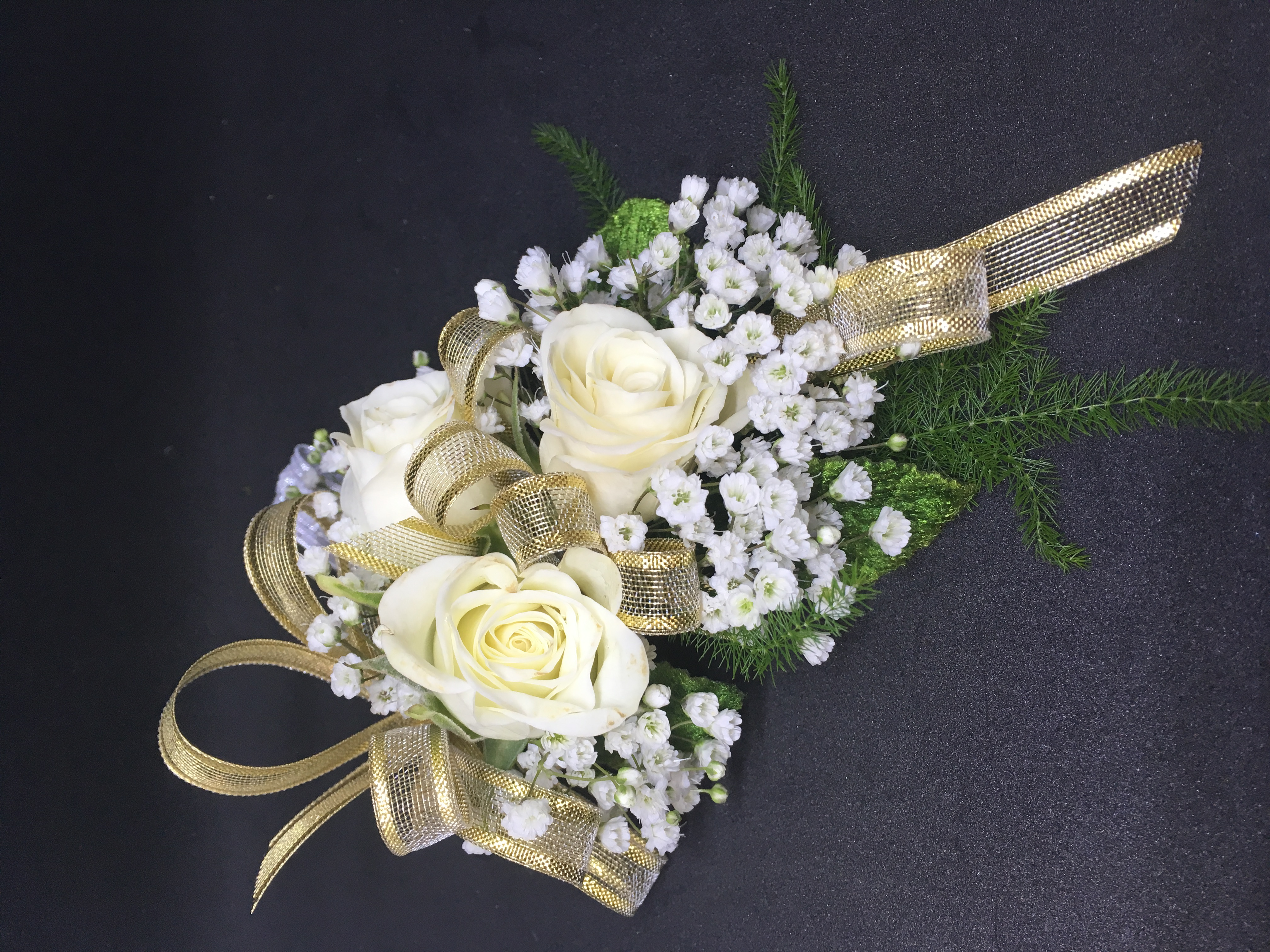 White spray roses and gold ribbon