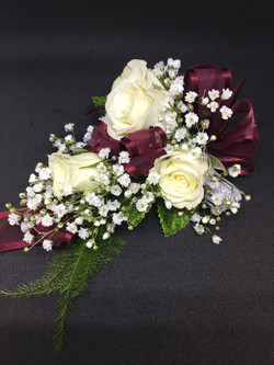 White spray rose & burgundy corsage