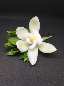 Cymbidium Boutonniere with Ruscus