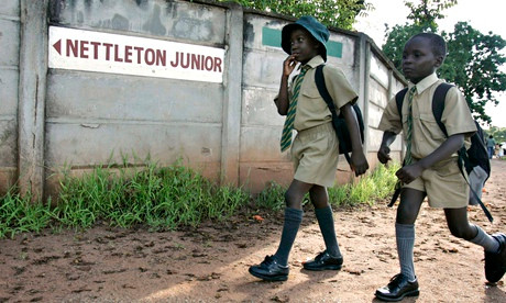 Students walk to school in Harare, Zimbabwe. The country spent less than 10% of its national budget on education in 2001. Photograph: Philimon Bulawayo/Reuters