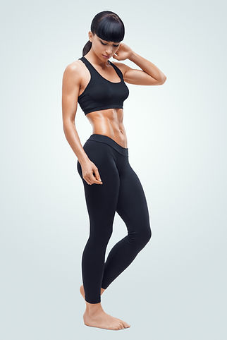 Fitness sporty woman showing her well tr