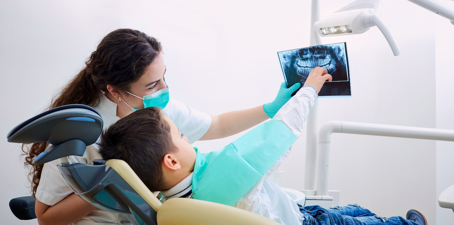 Dentist showing xray to child