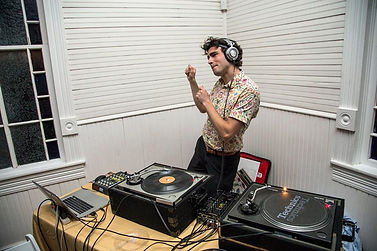 DJ Phildoesit dances while DJing a wedding with vinyl records at Mercury Hall in Austin, TX during March 2017.