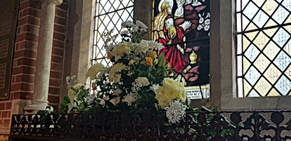 flowers in church window.jpg