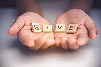 """The word """"GIVE"""" in hands in cupped shape"""