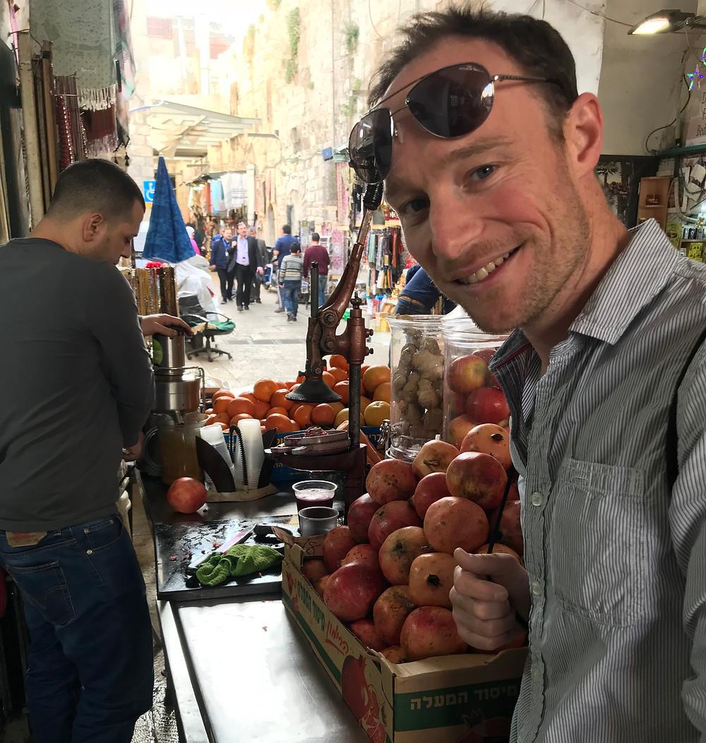 A street vendor blends making pomegranate juice with ginger in the Old City of Jerusalem