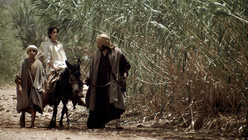 Jesus' young family walking home from Jerusalem