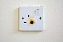 Damaged electric socket.jpg