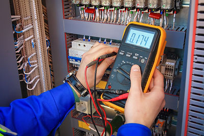 Electrical Engineer adjusts electrical e