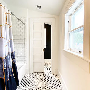 heather homes.pocketdoorbathroom.jpg