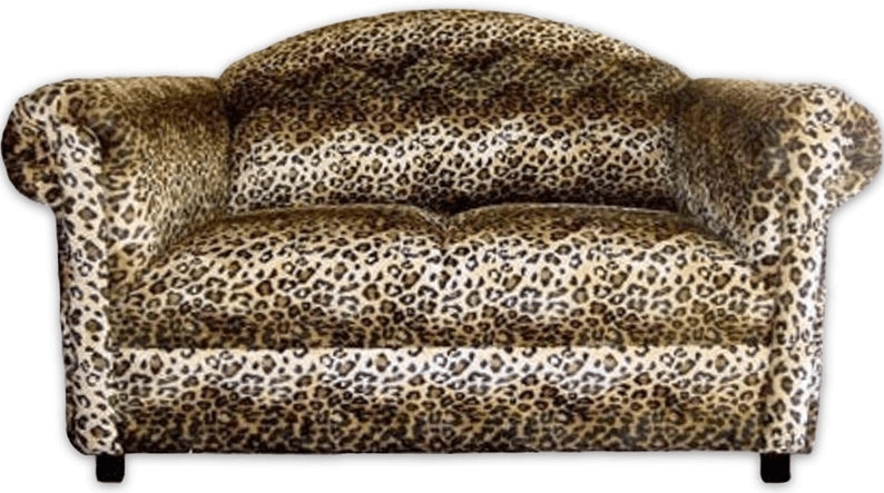 funky loveseat upholstered in brown leopard