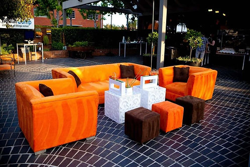 orange sofa and two chairs