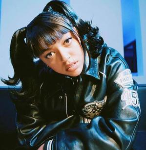 Mahalia wears Phat Farm Leather Jacket