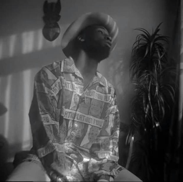 Kojey Radical wears Fubu Allover Print Shirt