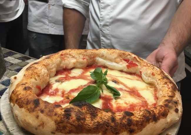 The real pizza margherita made by a professional pizza chef, Marco Fuso