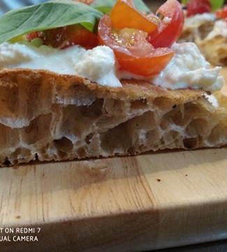 Italian focaccia with mozzarella and tomatoes