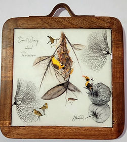 the wings collection trivet in mango woo