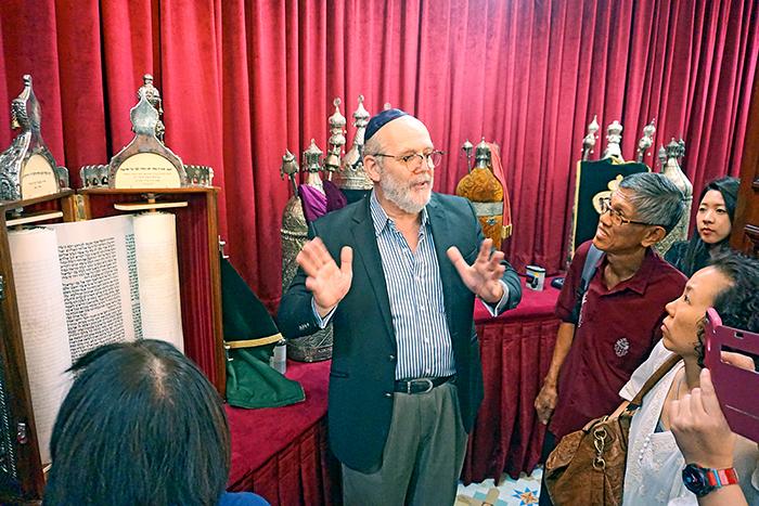 The Catholic News Singapore - Rabbi Asher Fettmann - Standing next to a Torah scroll
