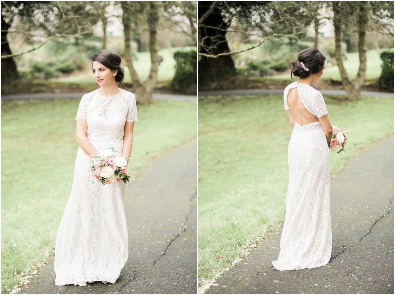 Beautiful bride in lace dress with pink and white flowers for winter wedding at Malvern Registry Office Worcestershire