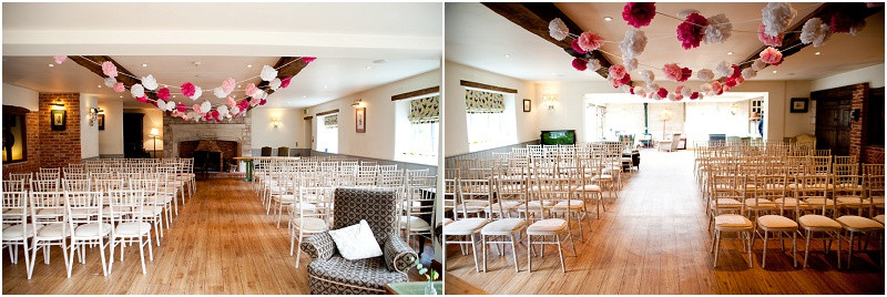 Ceremony room decorated with pom poms at The Moonraker wedding venue Wiltshire