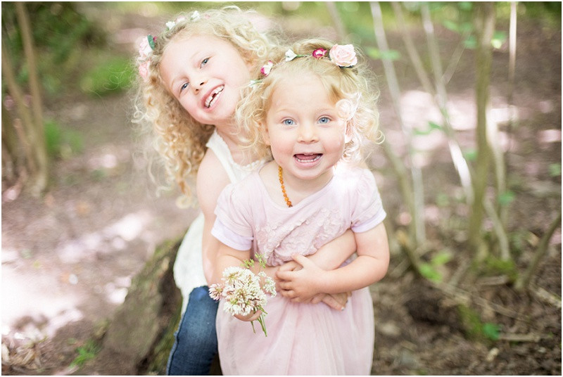 Family photography Cotswolds sister with flower crowns