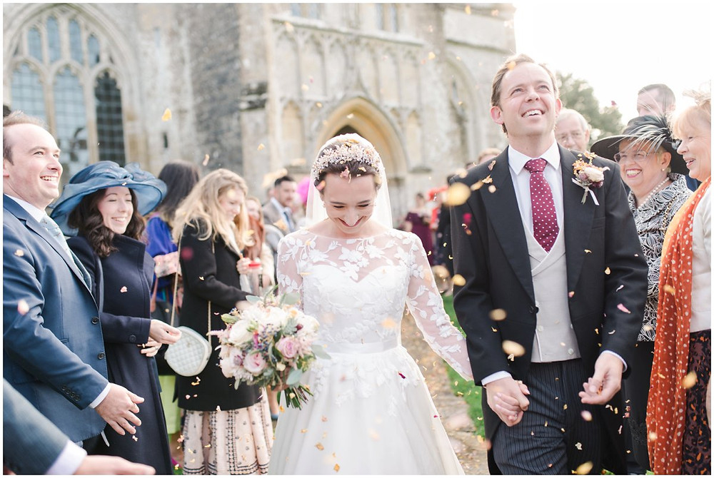 Bride and groom outside church at North Cadbury Court Somerset wedding