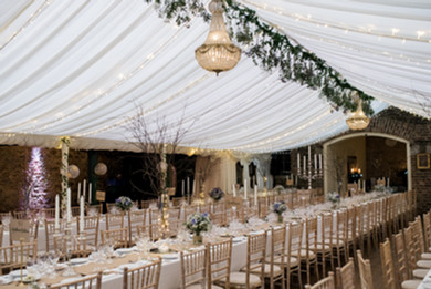 Boho style marquee with hanging foliage and candles at Trudder lodge Dublin wedding venue