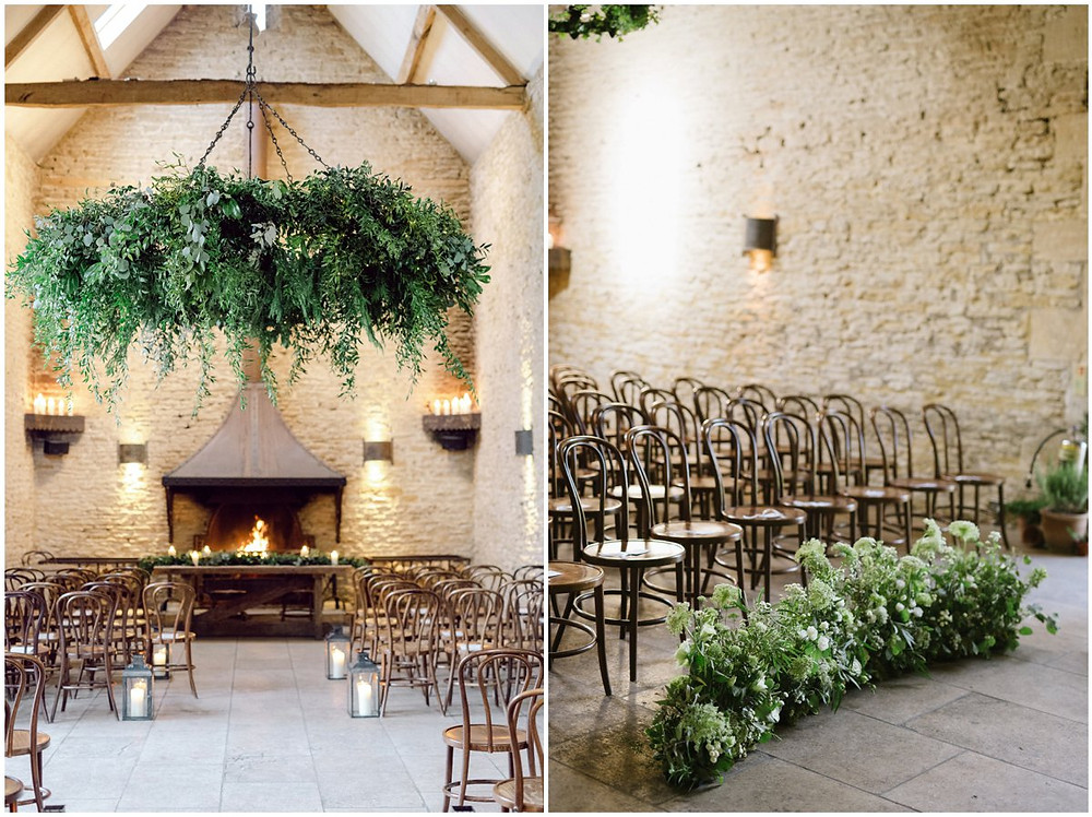 Stone Barn Cotswolds wedding venue with rustic chairs and a meadow flower aisle