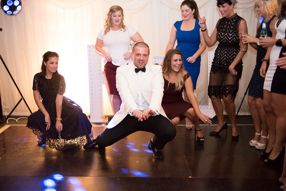 groom dancing to Beyonce All the Single Ladies at wedding venue The Outbuildings Anglesey
