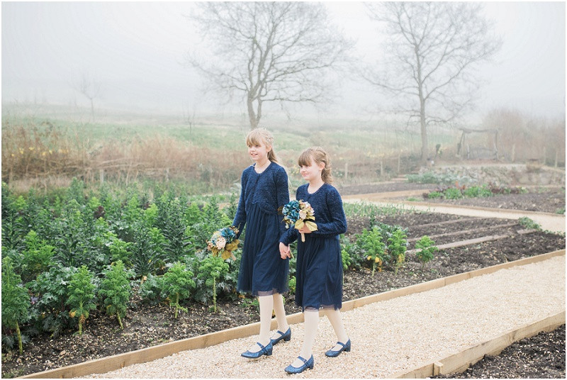 Bridesmaids in navy blue for River Cottage wedding