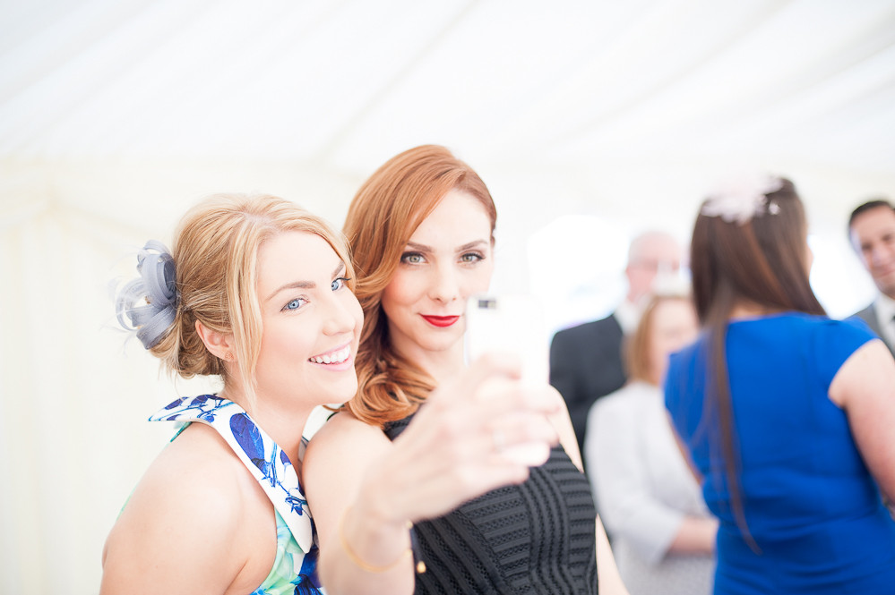 Wedding guests taking a selfie at The Outbuildings, Anglesey