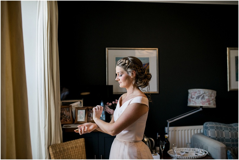 Bride in pink getting ready for beach wedding in Pembrokeshire